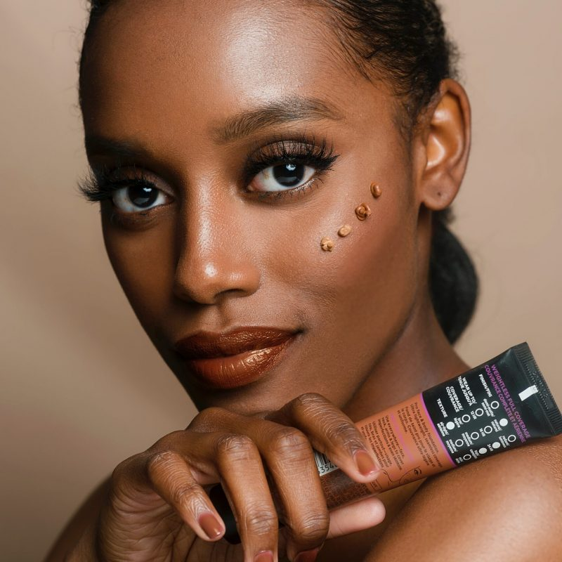 woman-holding-brown-and-black-soft-tube-2661256